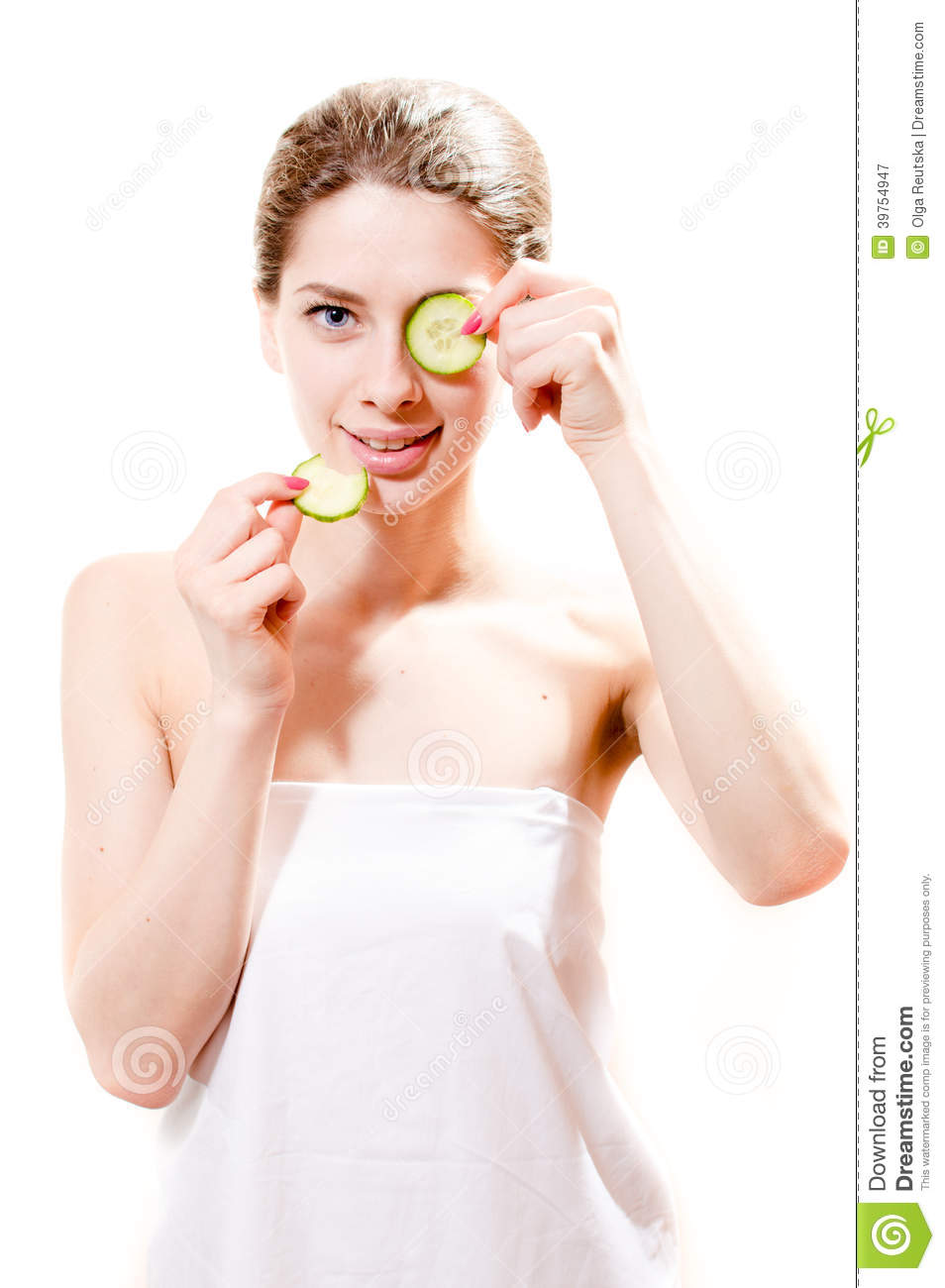 Spa young beautiful woman attractive girl standing with slices of cucumber in the hands one piece on eye isolated