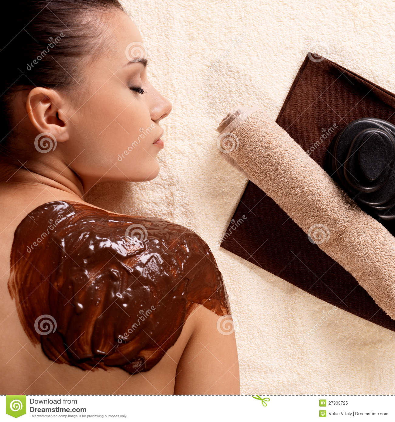 Spa for young woman receiving cosmetic mask royalty free for Salon younga
