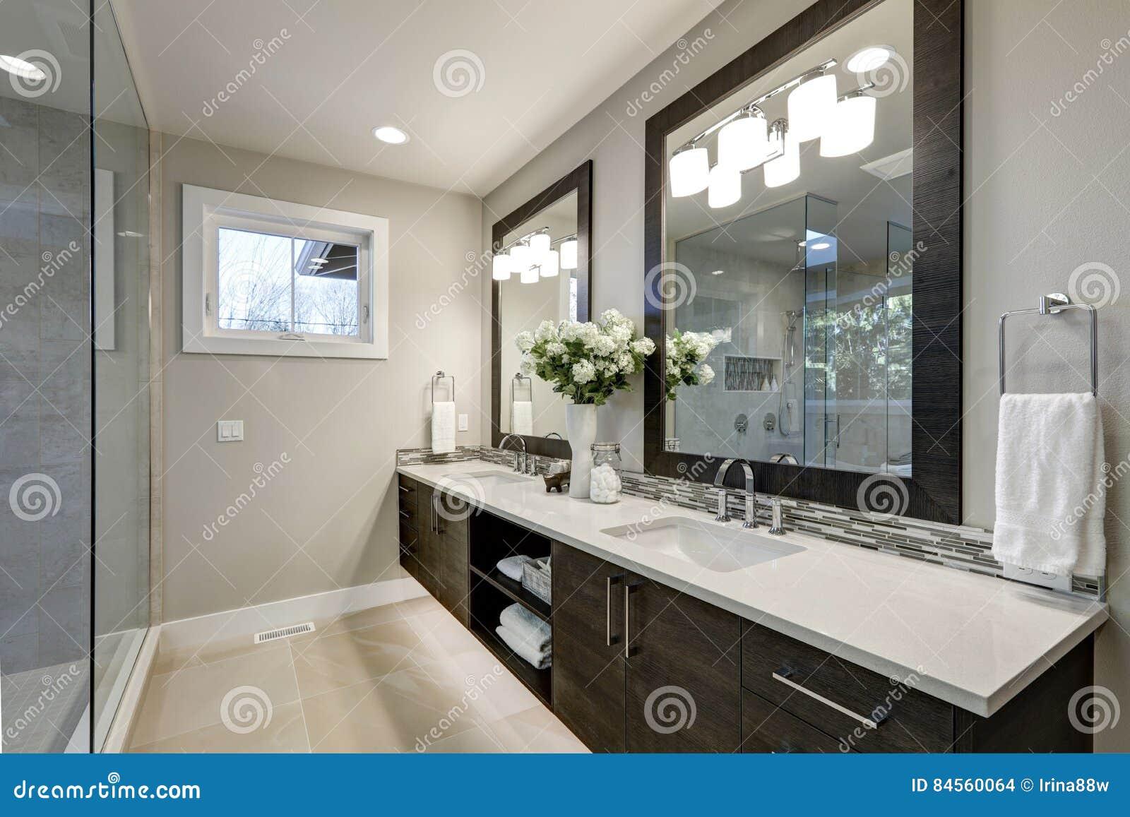 Spacious Bathroom In Gray Tones Wizth Long Vanity Stock Photo Image Of Building Architect 84560064