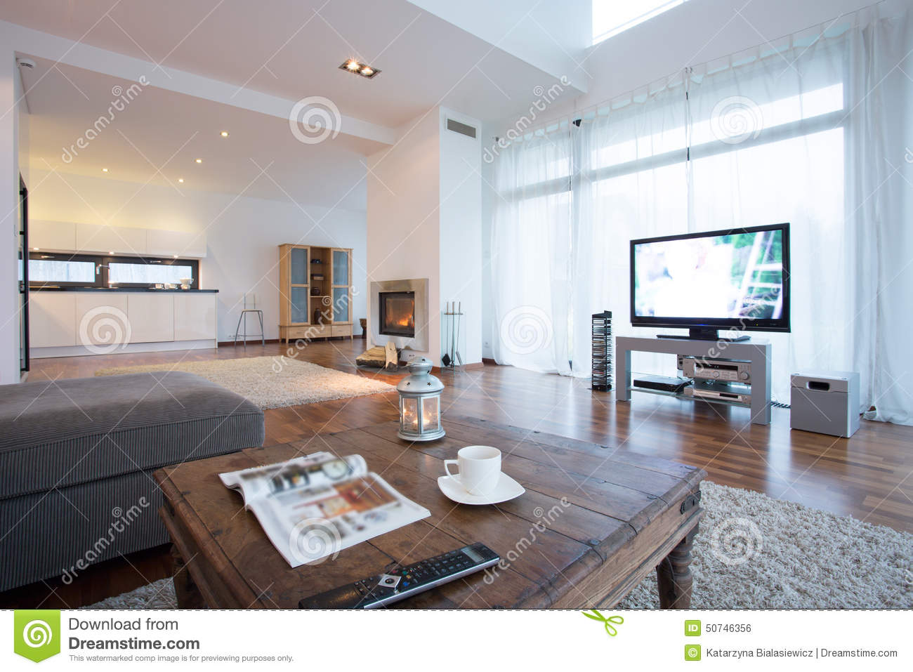spacious and bright living room with tv stock photo. Black Bedroom Furniture Sets. Home Design Ideas