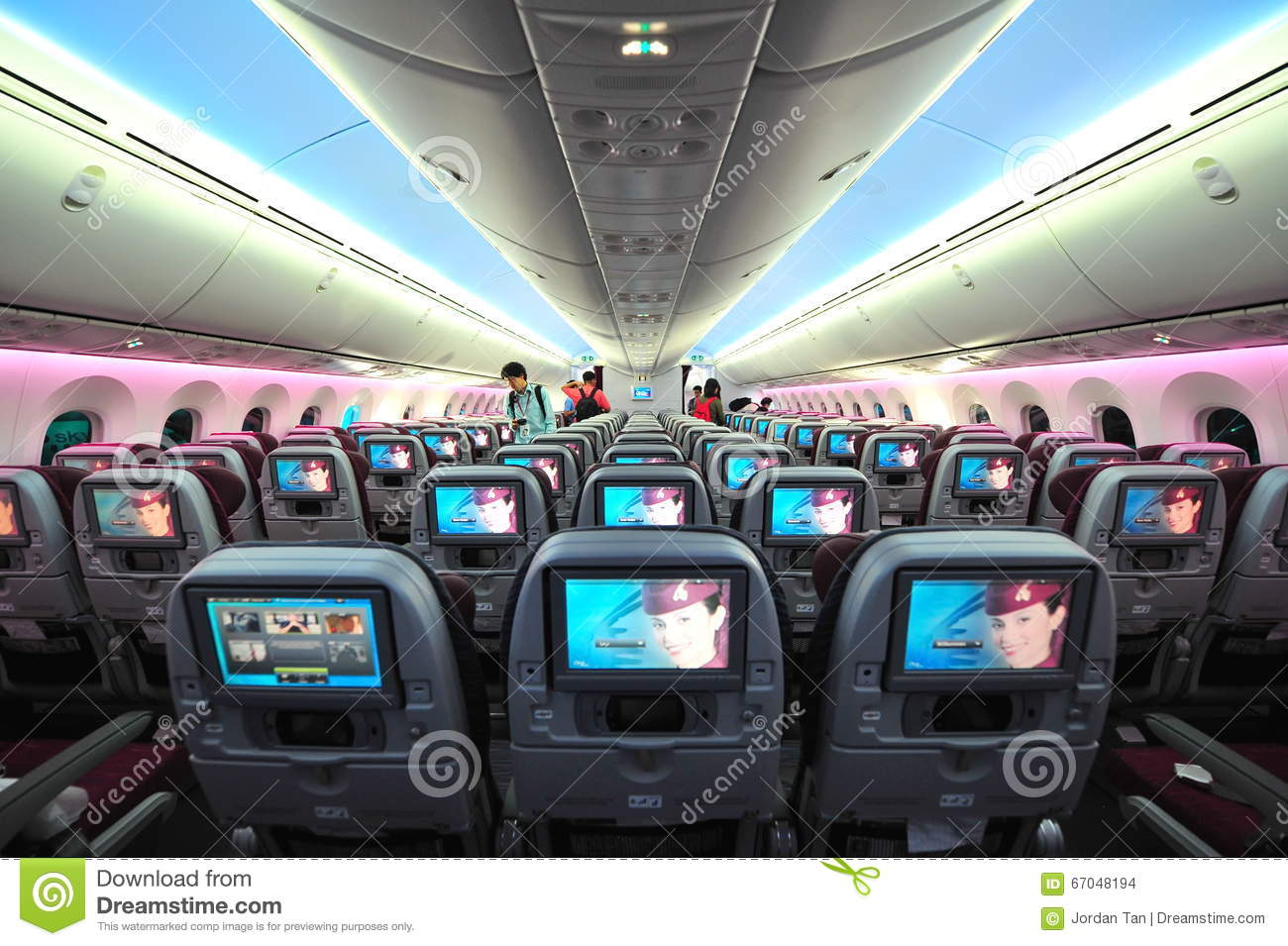 Spacious and comfortable economy class cabin of Qatar Airways Boeing 787-8 Dreamliner at Singapore Airshow