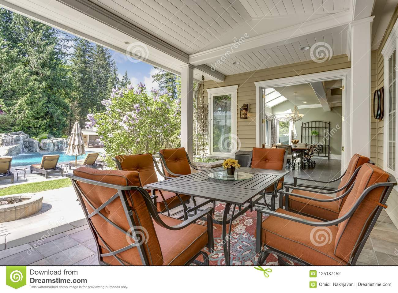 Spacious Covered Deck Patio With Table And Red Chairs Stock Photo Image Of Exterior Cozy 125187452