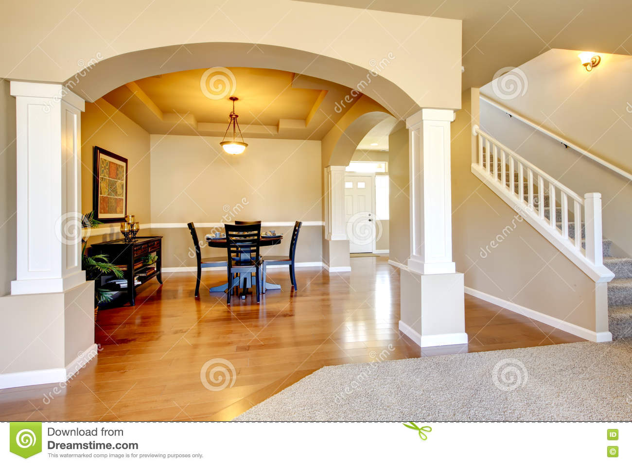 Spacious Dining Room With White Columns And Beige Tray Ceiling Stock Photo Image 75280132