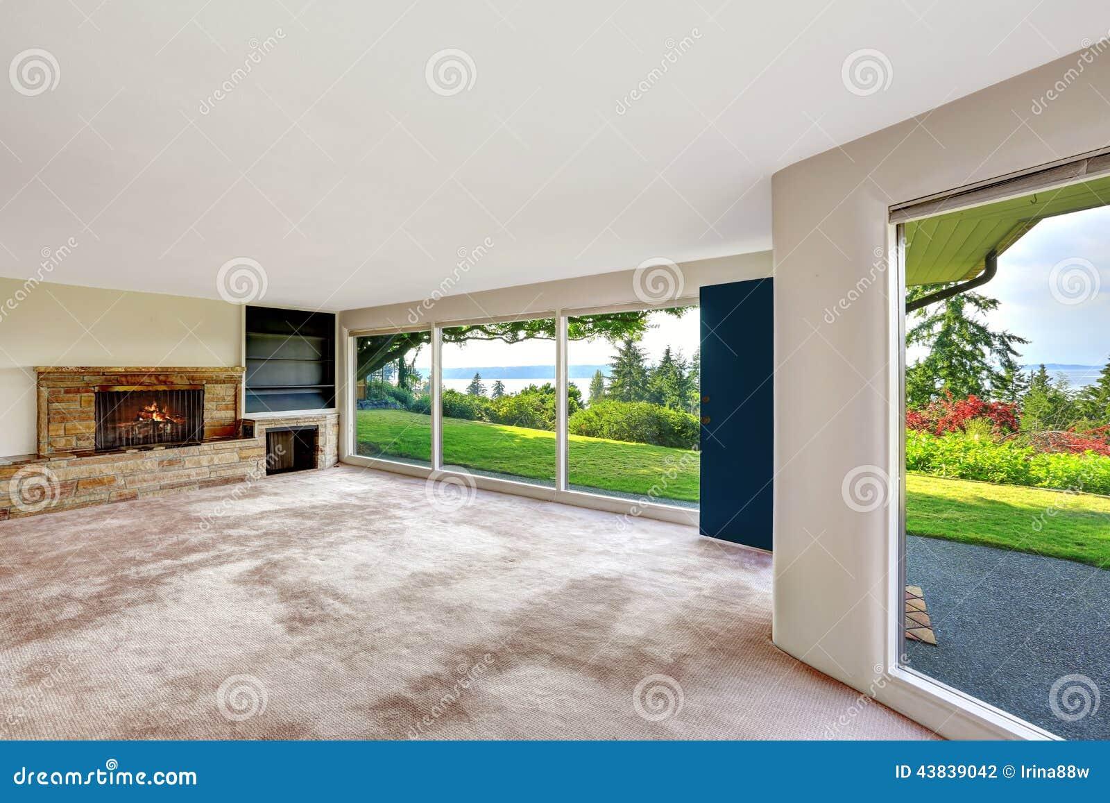 basement windows interior. Spacious Empty Living Room With Walkout Basement Overlooking Bea. House, Glass. Windows Interior