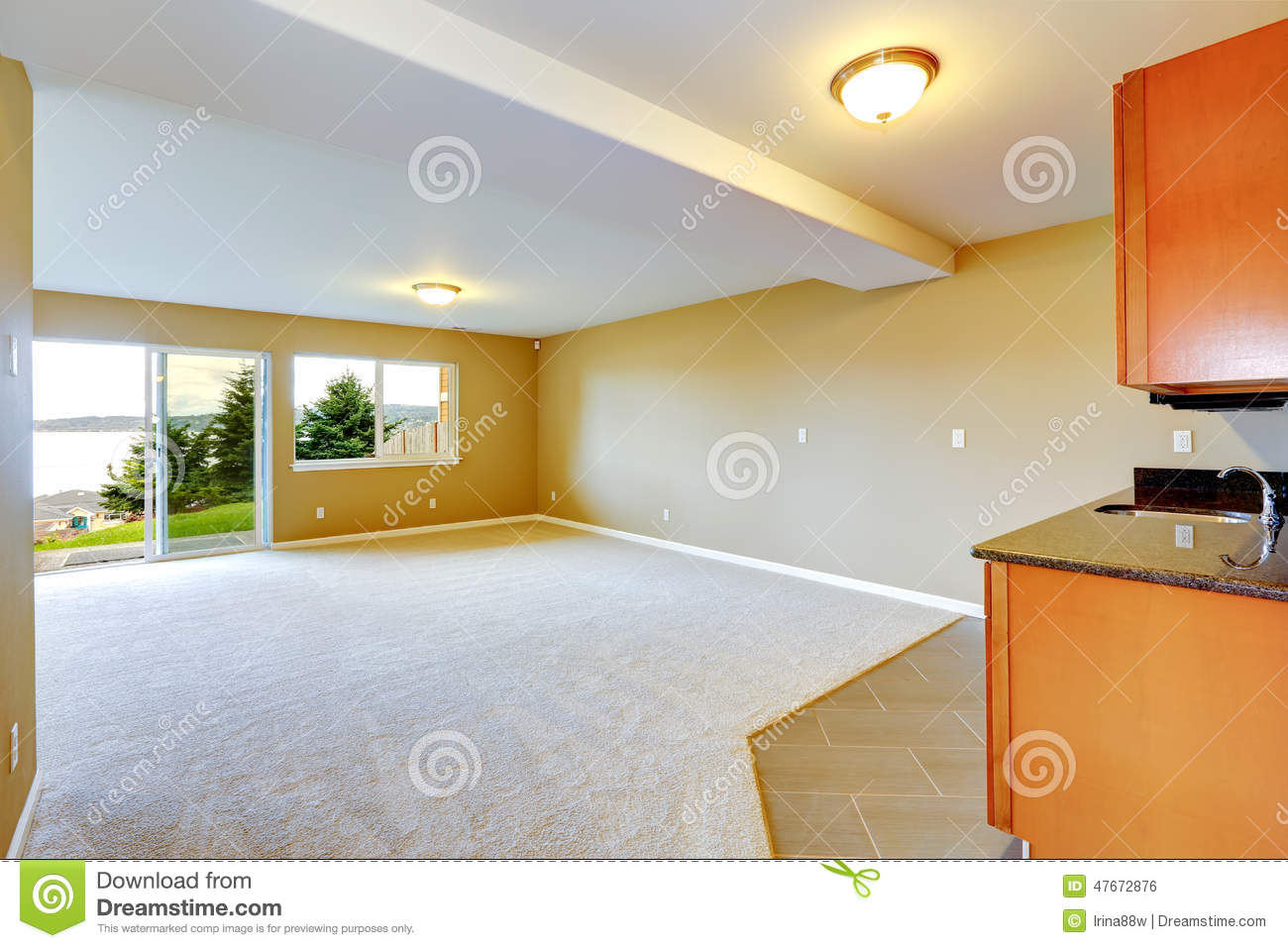 Spacious Family Room With Kitchen Cabinets Stock Photo