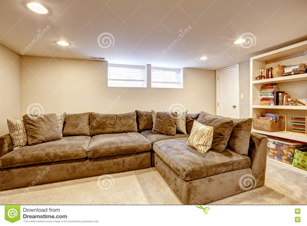 Spacious Family Room With Large Corner Sofa And Bookcase