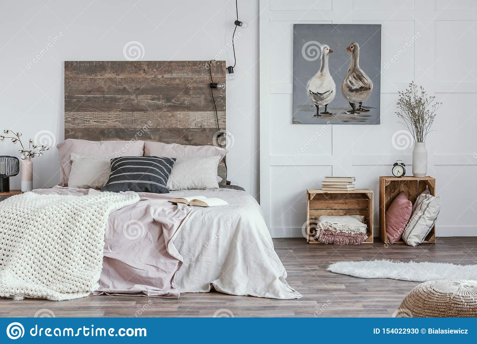 Spacious Feminine Bedroom Interior With Rustic Furniture White Walls Wooden Crates And Oil Painting Of Animals Real Photo Stock Photo Image Of Furniture Decor 154022930