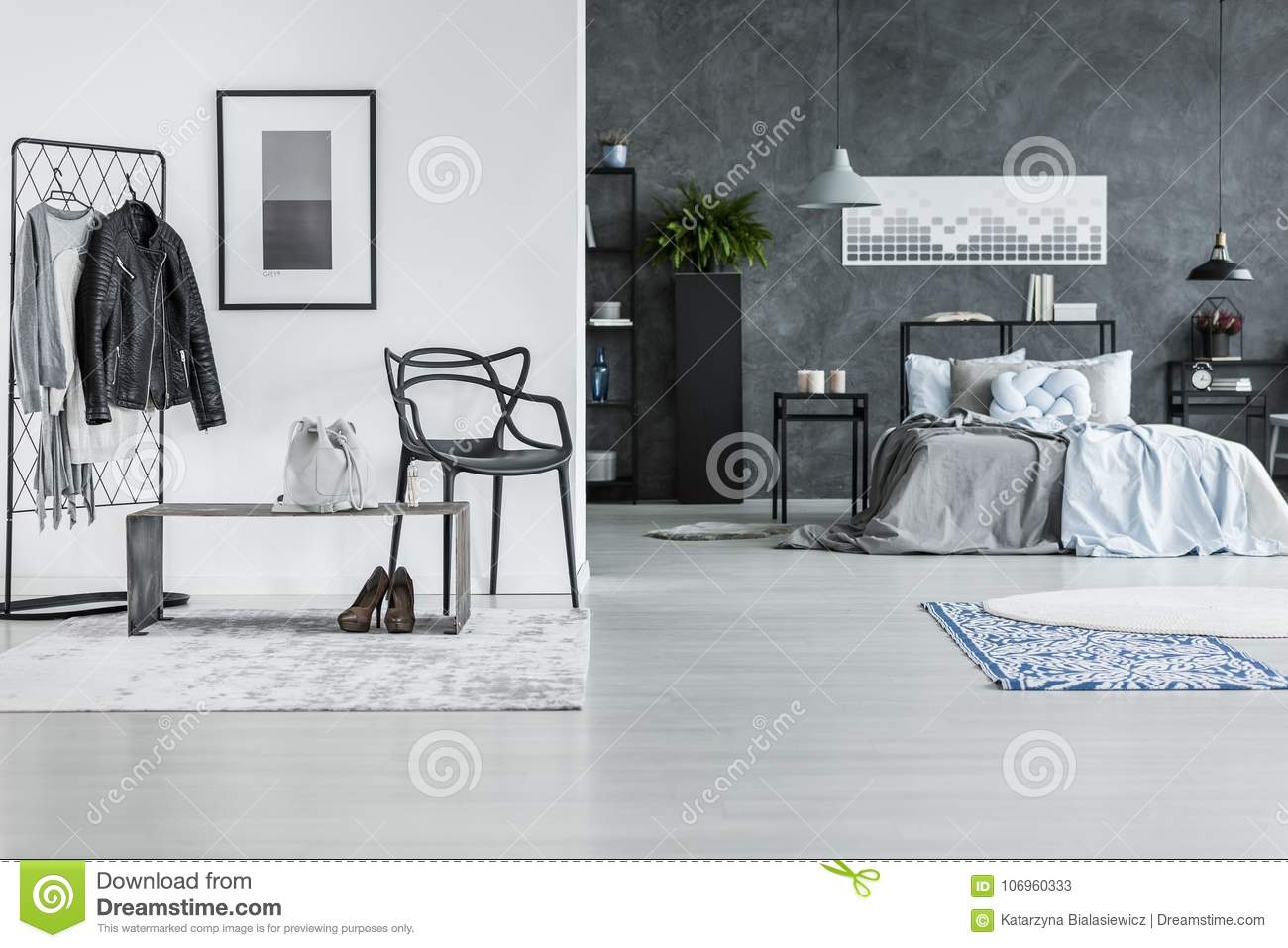 Attractive Black Chair Next To Bench In Anteroom In Spacious Grey Bedroom Interior  With Rugs, Lamps And Poster On Dark Wall Above Bed