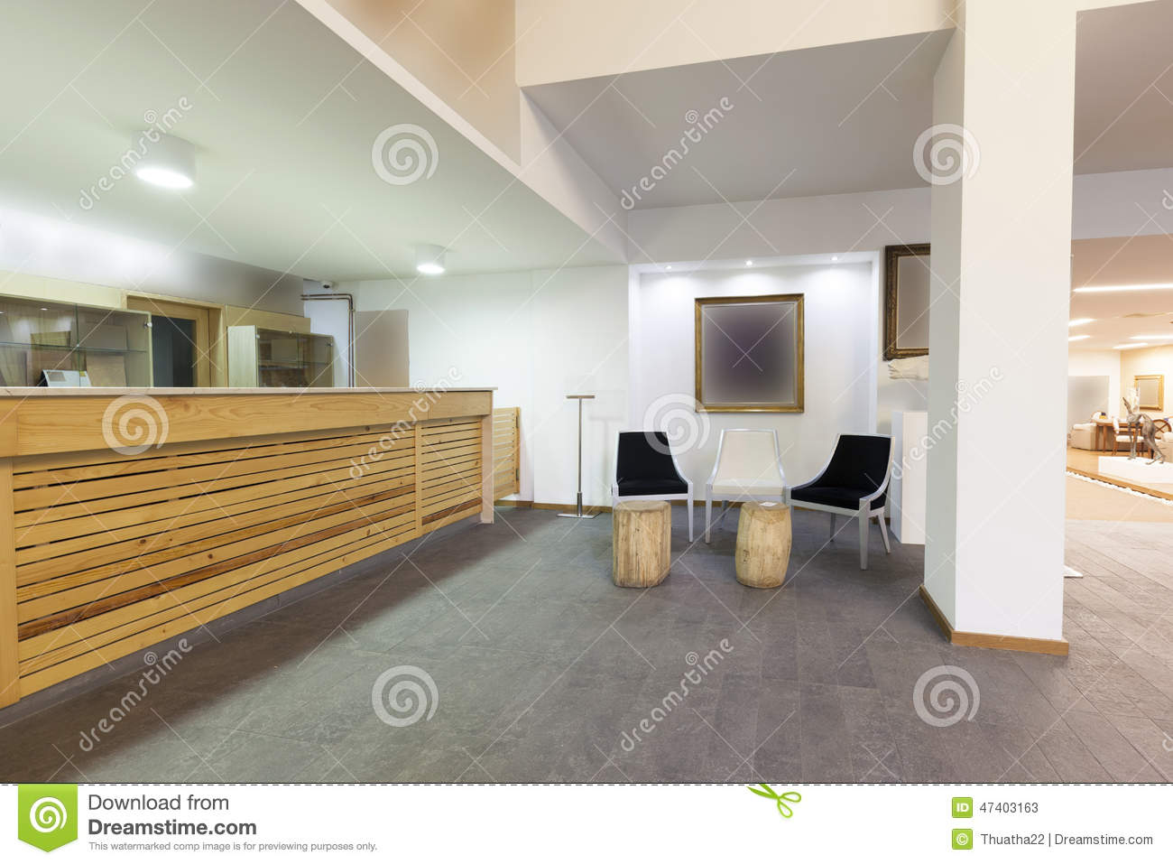 Spacious Hotel Lobby With Reception Desk Stock Photo