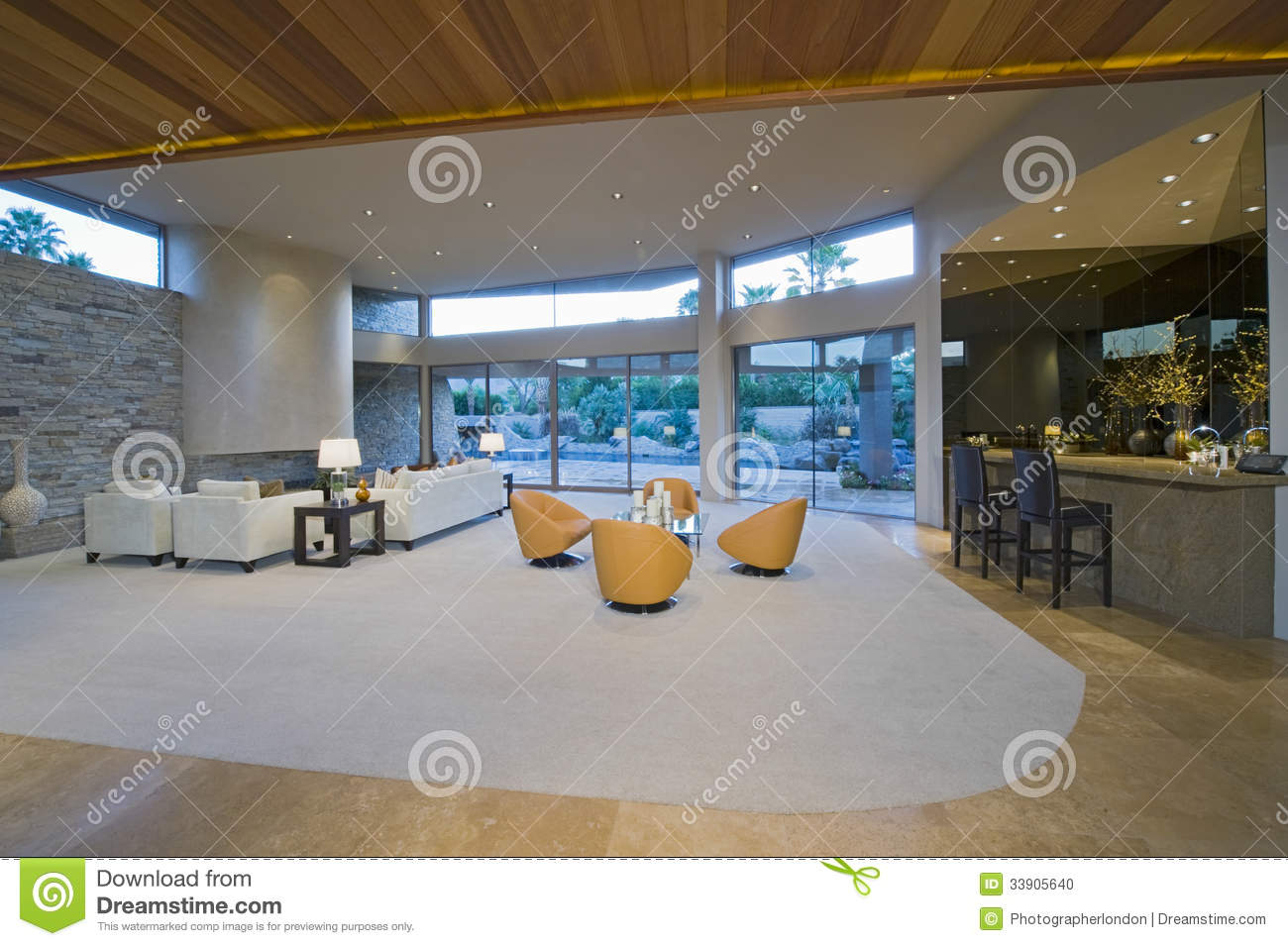 Spacious living room by bar area against porch stock photo for Sitting room bar