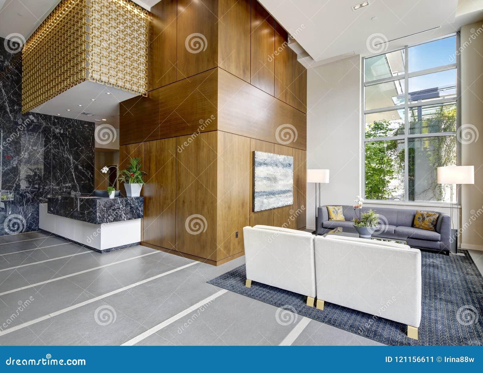 Spacious lobby area in a modern luxurious condominium.