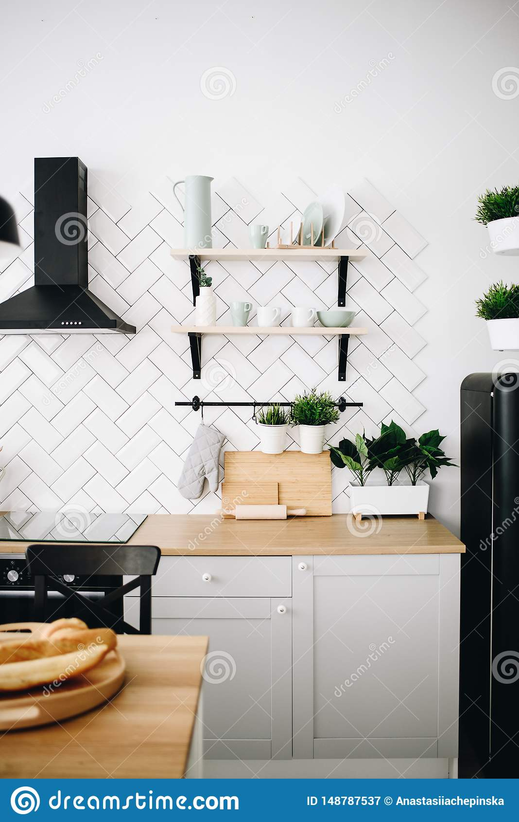 Spacious Modern Scandinavian Loft Kitchen With White Tiles And Black Appliances Bright Room Modern Interior Vertical Image Stock Image Image Of Decoration Placemat 148787537