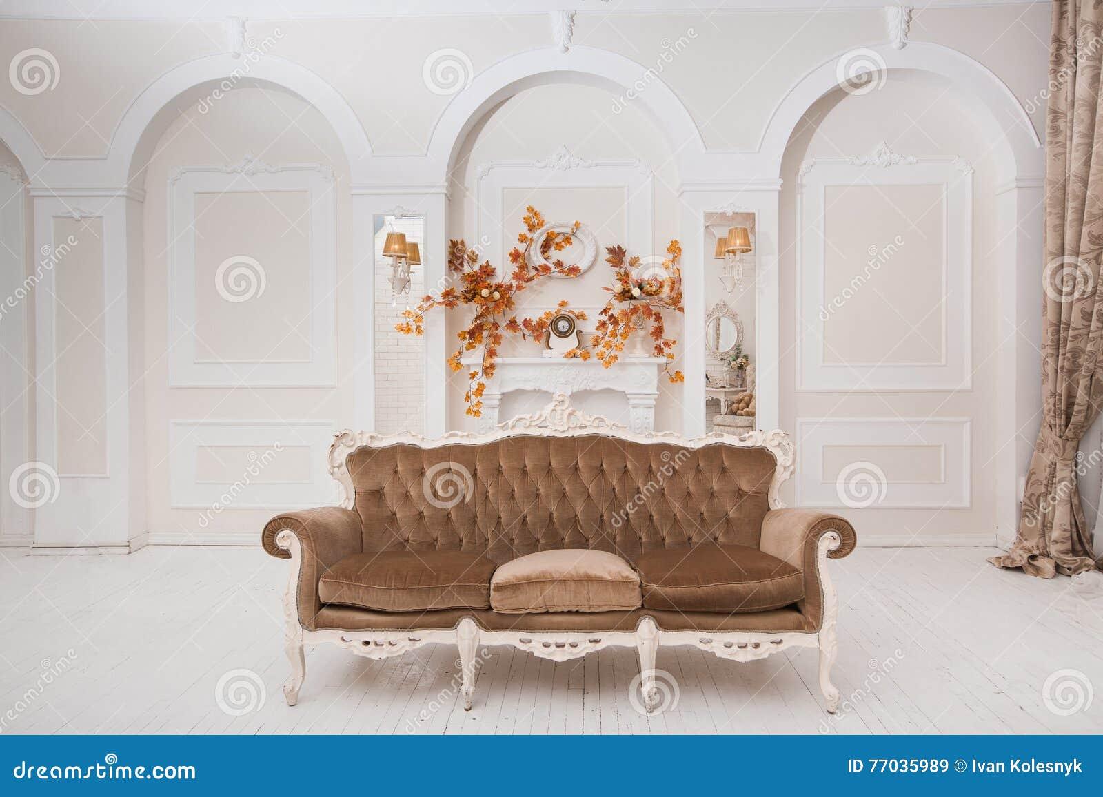 Spacious White Wedding Hall With Autumn Decoration Stock