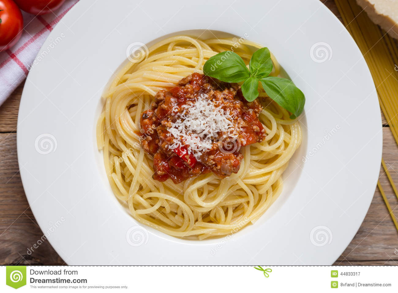 Spaghetti With Bolognese Sauce Parmesan And Basil Stock Photo - Image ...