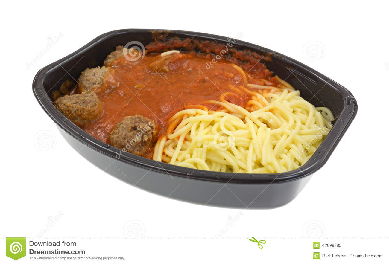 freshly cooked spaghetti and meatball TV dinner in the black plastic ...