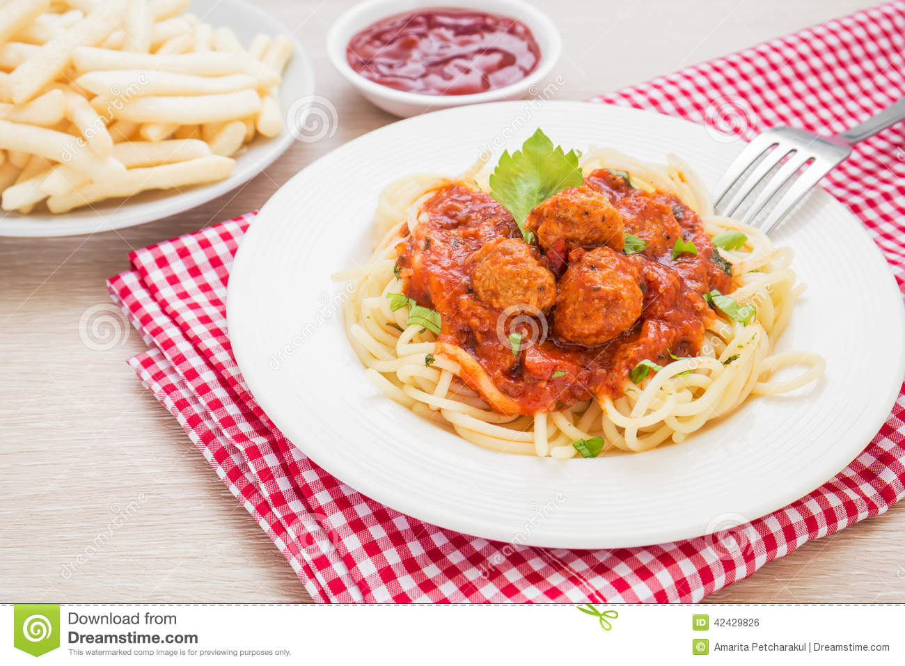 Spaghetti With Meatballs In Tomato Sauce And French Fries