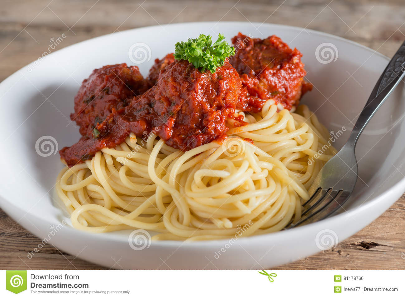 Spaghetti and Meatballs in white plate.