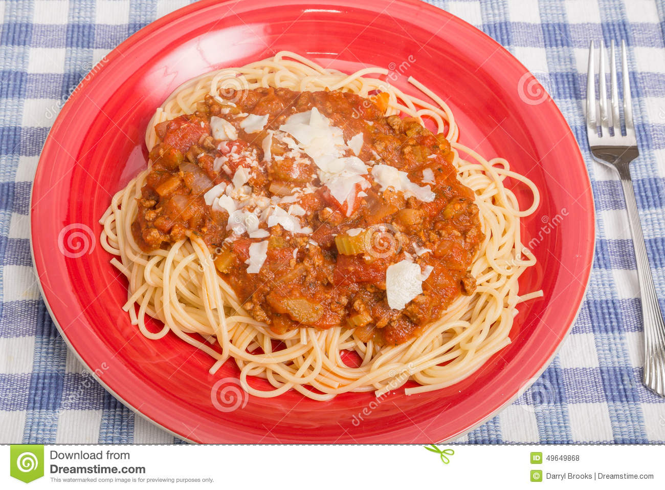 plate of delicious spaghetti with meat sauce.