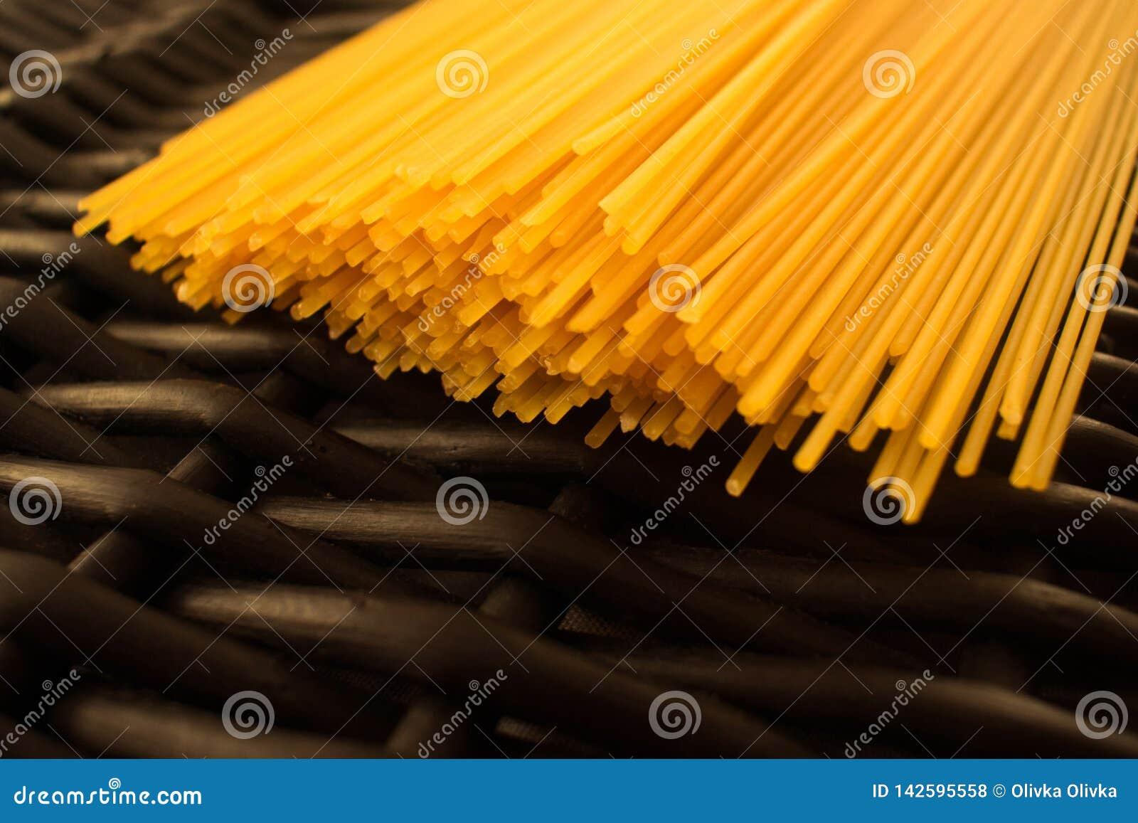 Spaghetti pasta raw black background
