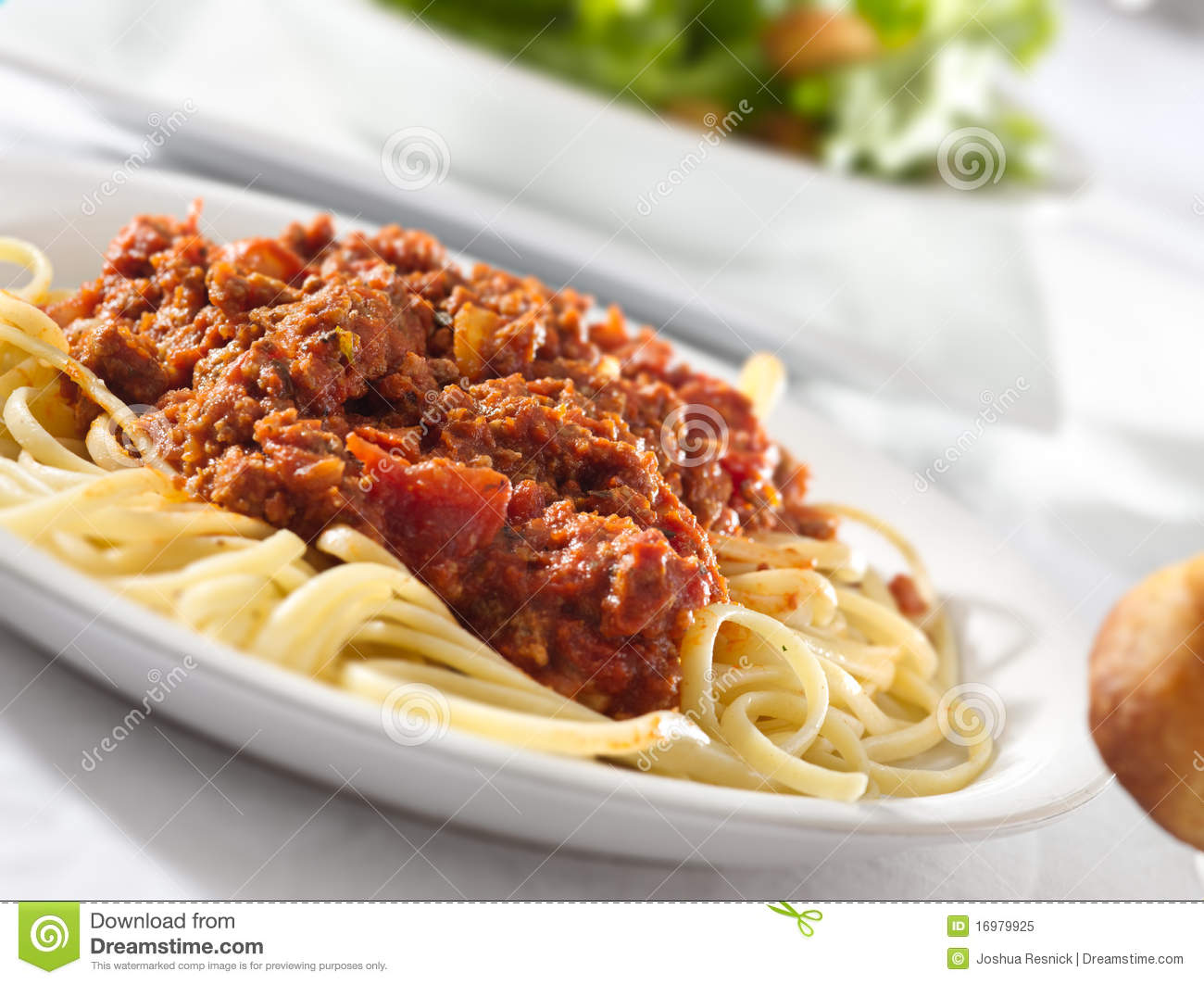 Selective focus on a plate of spaghetti pasta with tomato beef sauce.