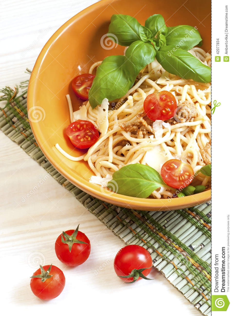 ... spaghetti bolognese with tomato and meat sauce and Parmesan cheese