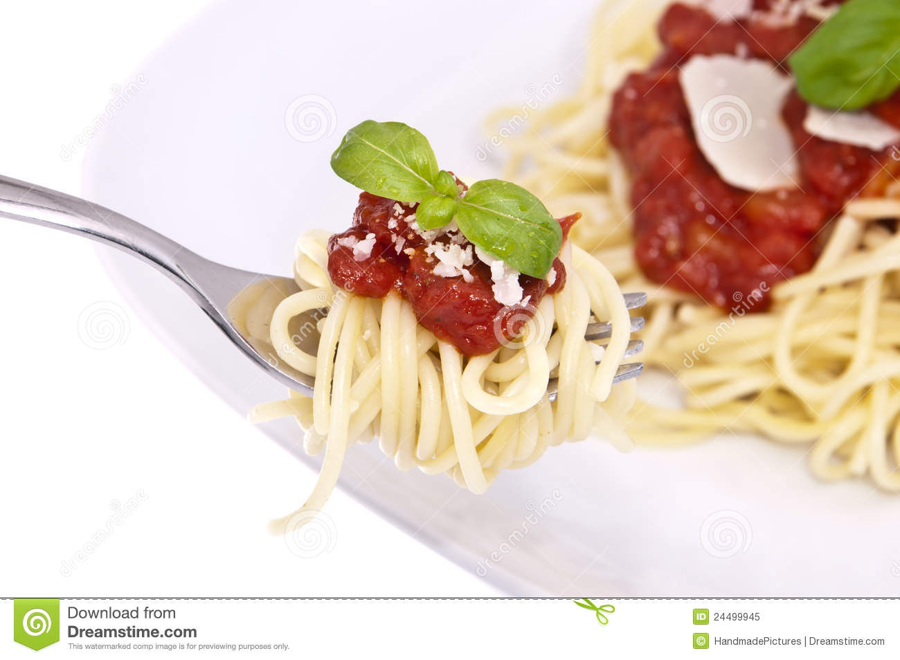 Spaghetti with tomato sauce, basil and parmesan cheese on a fork.