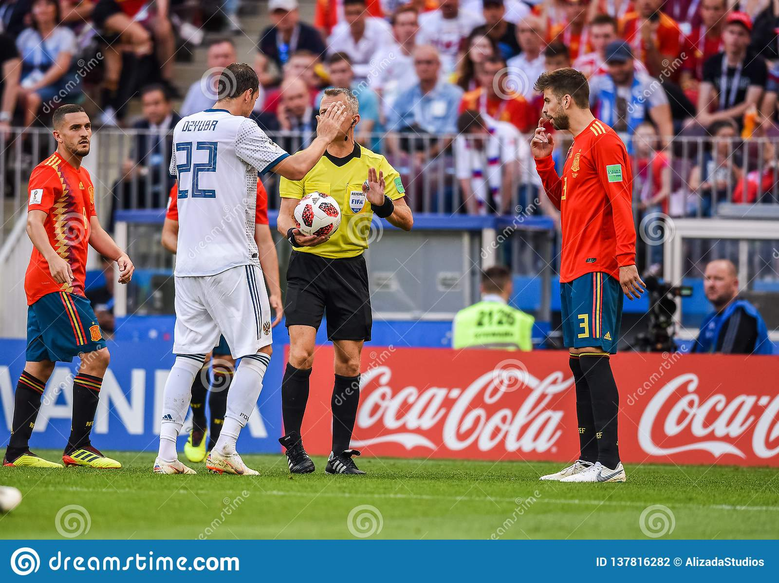 ca0affe15 Spain national football team players Gerard Pique and Koke with Russia  national team striker Artem Dzyuba and referee Bjorn Kuipers during FIFA  World Cup ...