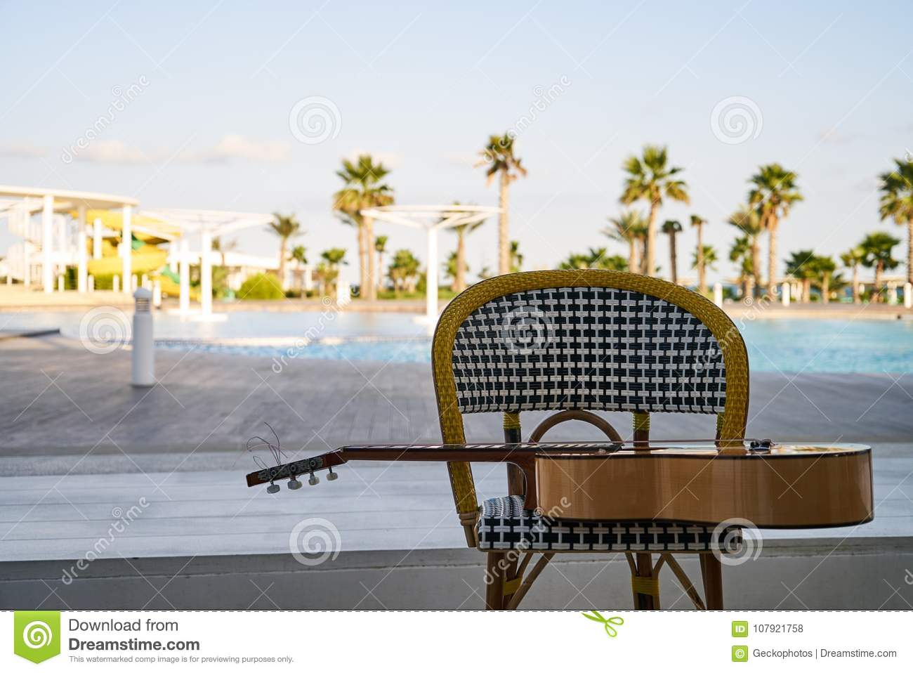Peachy Spanish Acoustic Guitar On Chair Stock Photo Image Of Ocoug Best Dining Table And Chair Ideas Images Ocougorg