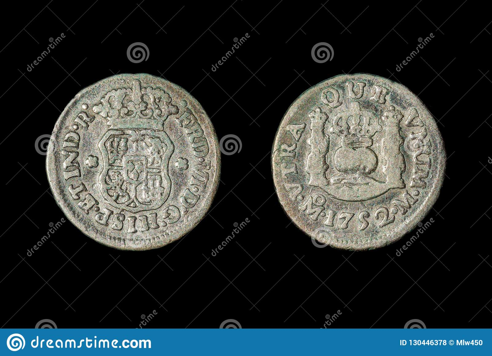 A 1752 Spanish half real coin, called a `picayune` in the United States. Isolated on black