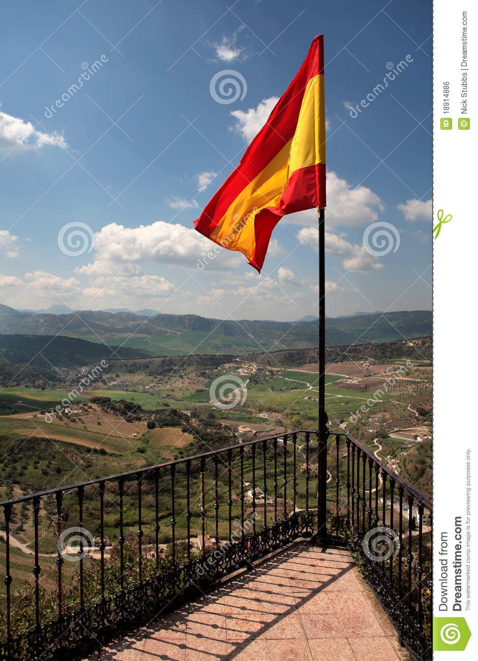 spanish flag flying over ronda in spain royalty free stock image