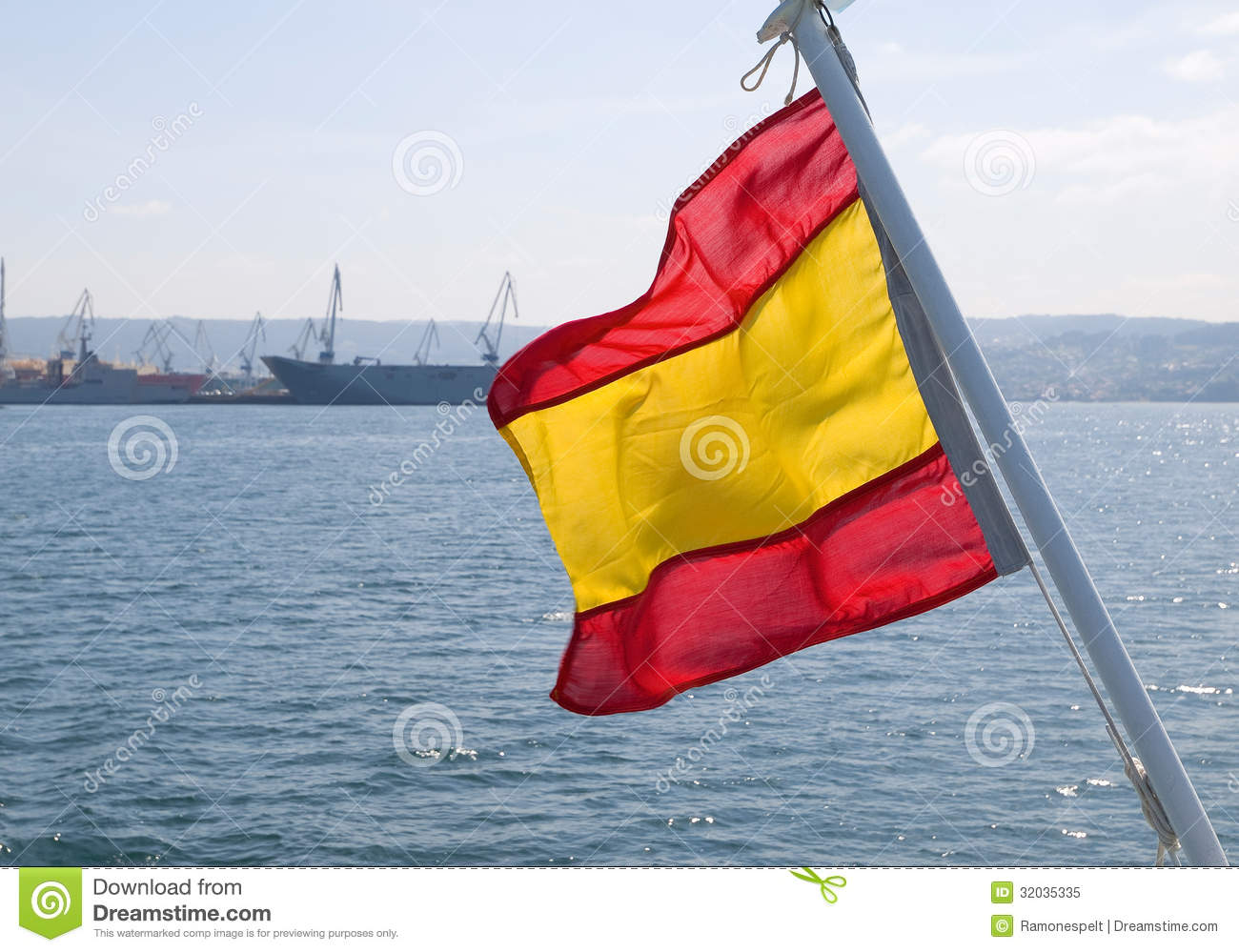 spain flag waving in the sea royalty free stock photo image