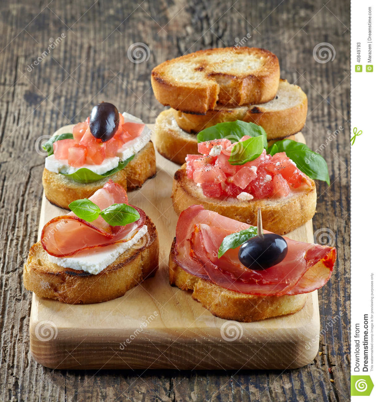 Spanish food tapas. Toasted bread with meat and vegetables.