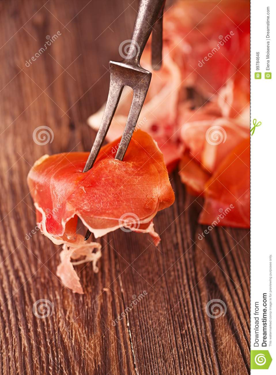 Spanish jamon Cured Meat on large vintage meat fork