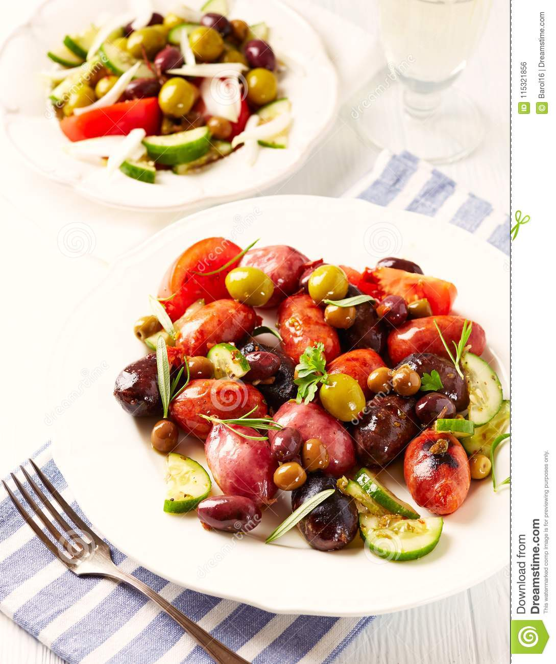 Spanish sausage with tomatoes, cucumber and different marinated olives