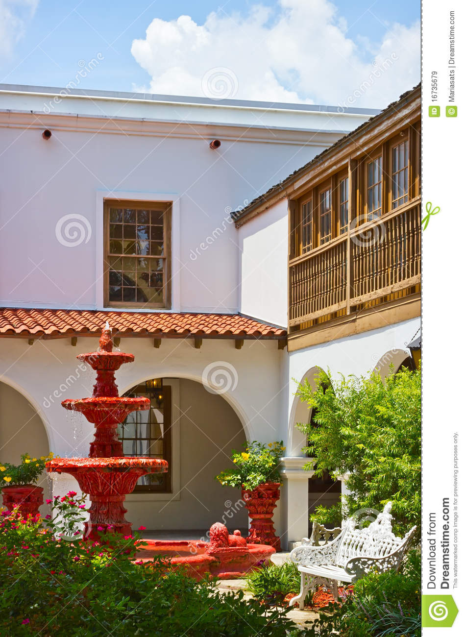 Spanish Style Patio With Red Fountain Stock Image Image