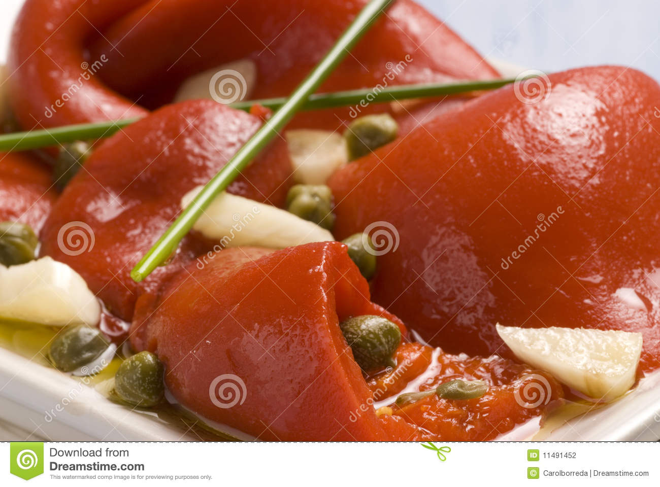 Spanish tapas. Roasted red pepper salad marinated in olive oil, chive ...