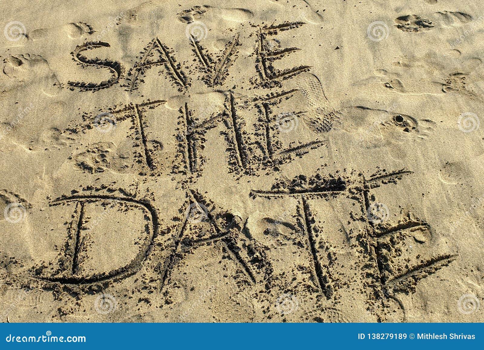 Spara det skriftliga datumbegreppet på sandstranden
