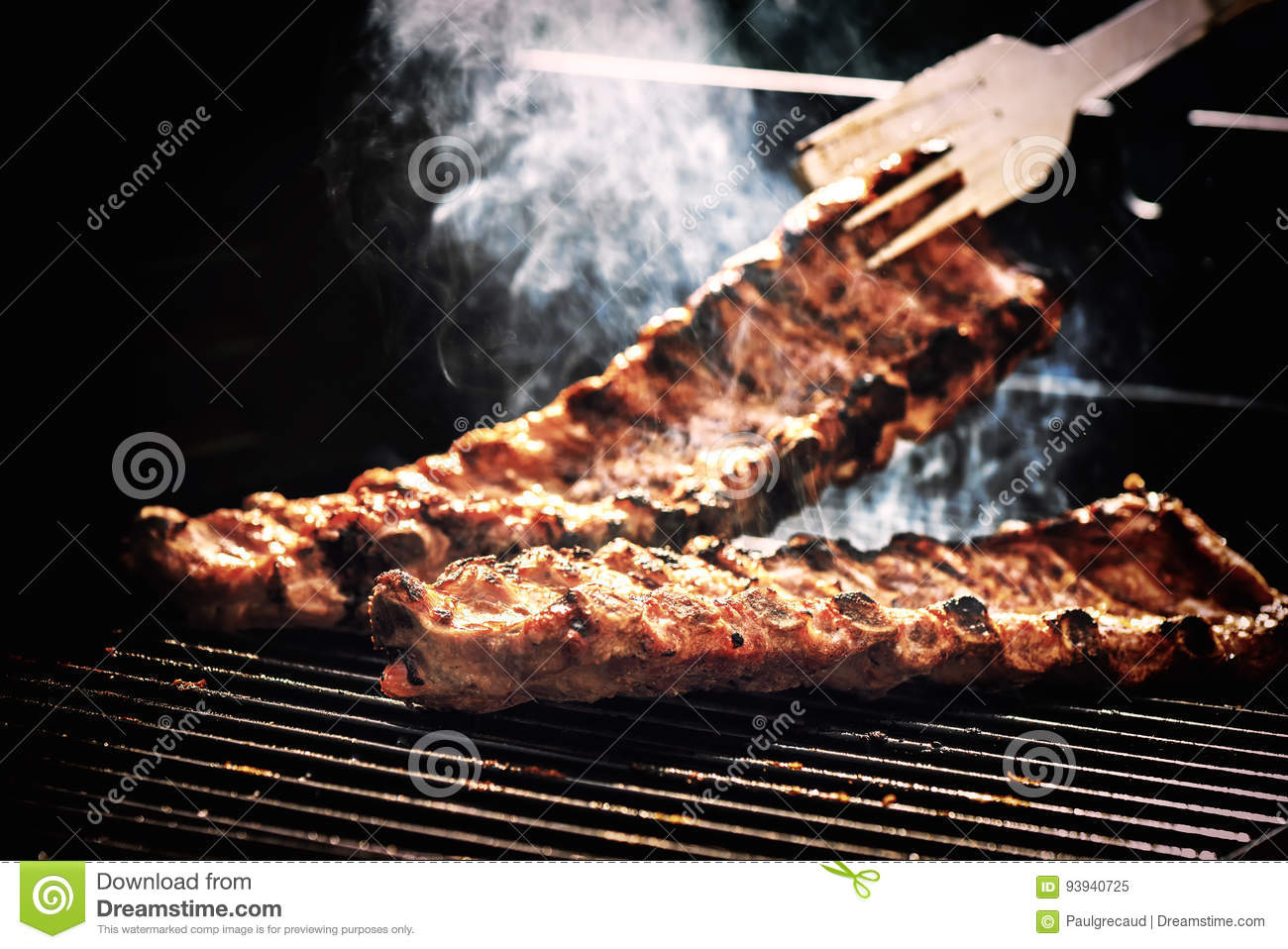 Spare ribs cooking on barbecue grill for summer outdoor party. F