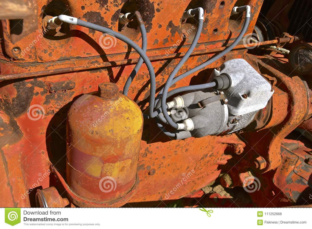 spark plug wiring of an old orange tractor