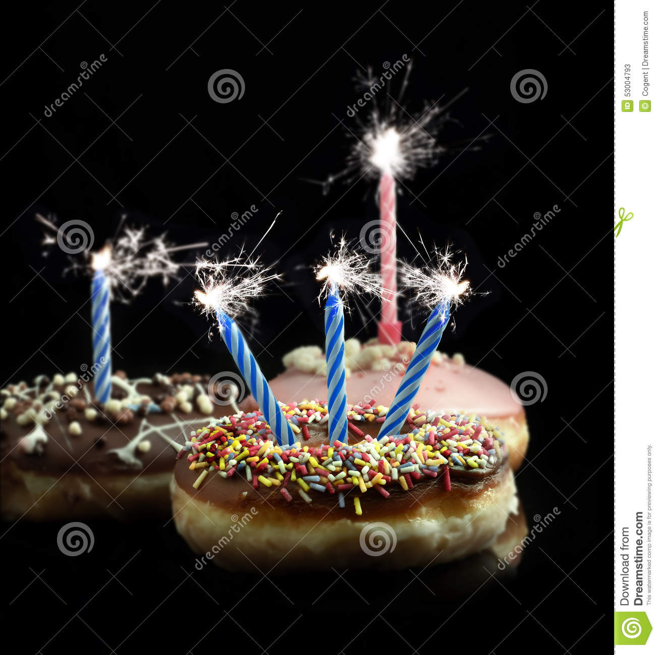 Image Of Delicious Donuts With Blue And Pink Candle Sparklers Against A Black Background Copy Space Concept For Celebrations Or Birthdays