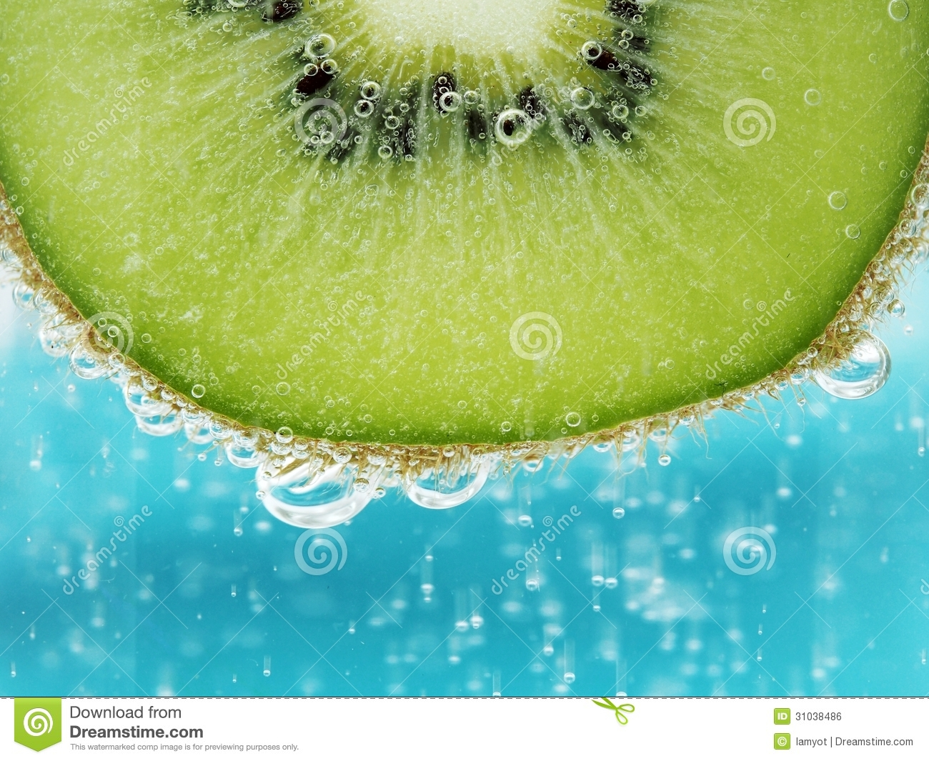 Half cut kiwi fruit isolated shot in sparkling water with cyan ...