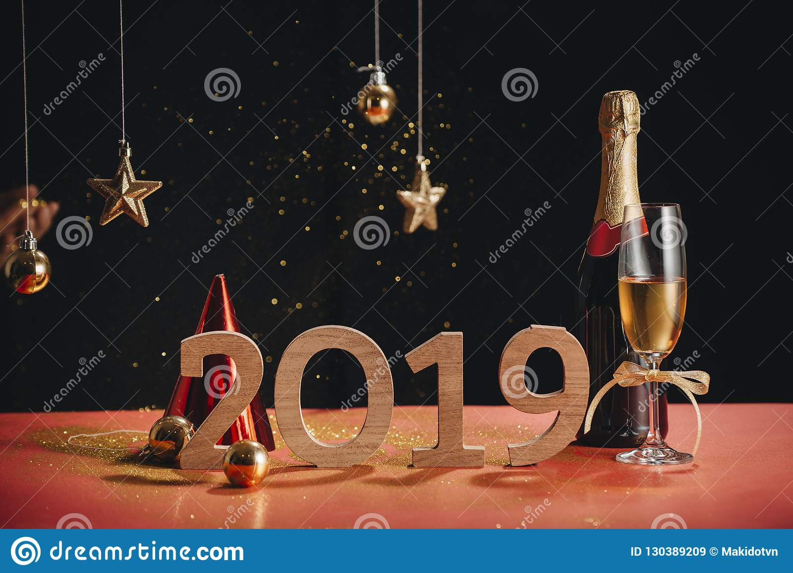 Sparkling New Year background, copy space. Champagne with decorations on New Year s Day