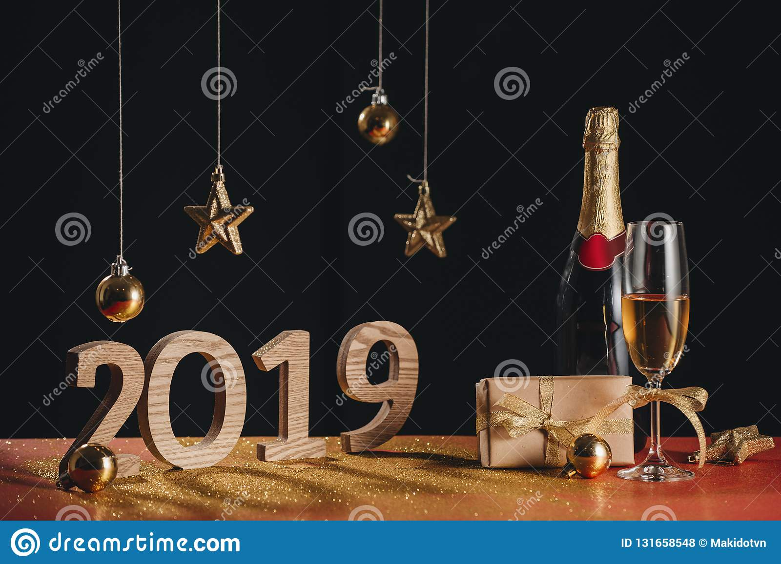 Sparkling New Year background, copy space. Champagne with decorations on New Year