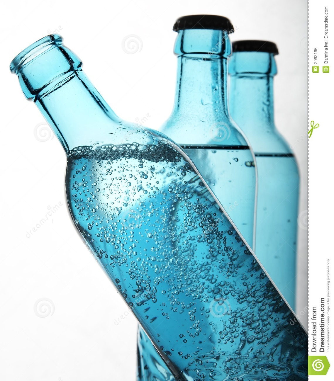 Mineral sparkling water in blue bottles on white background.