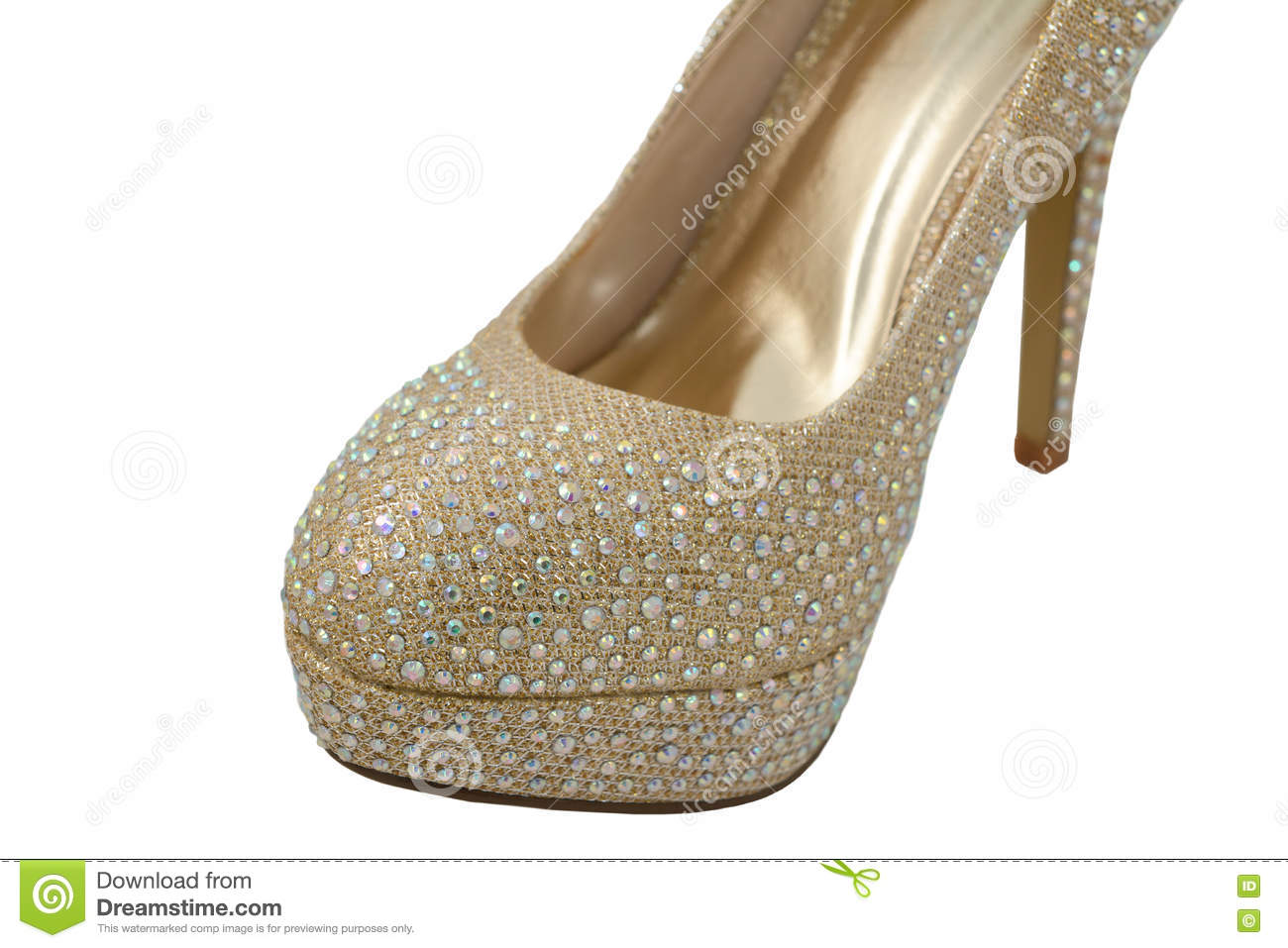 90b608077f Close-up of a fashionable high-heeled shoe, gold fabric covered in  glittering gems, isolated on a white background