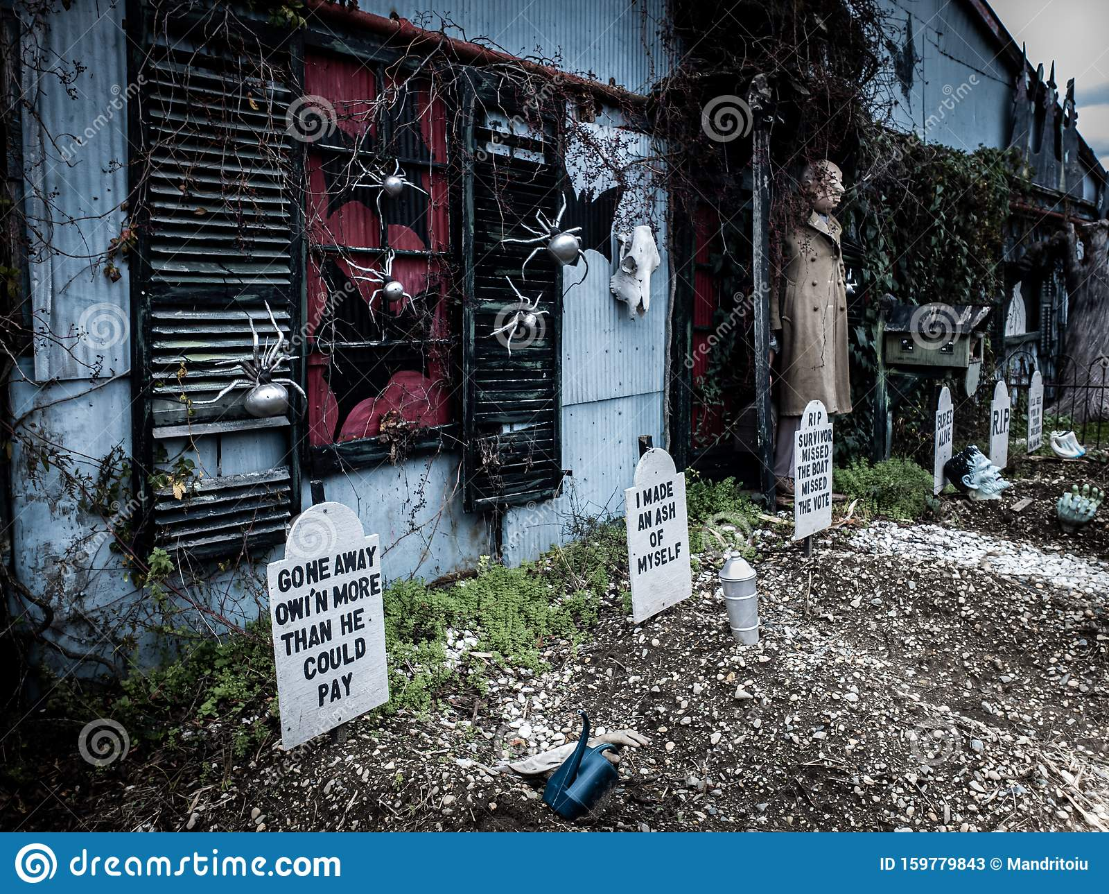 Funny Halloween Decorations In Front A Haunted House