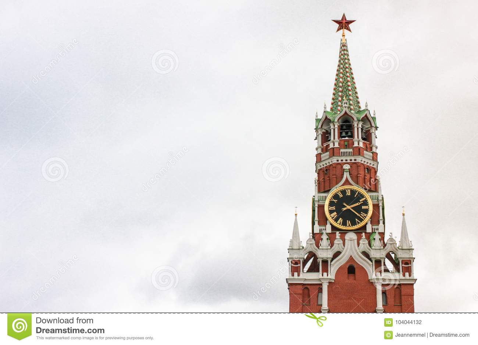Spasskaya Tower of the Moscow Kremlin against the white sky