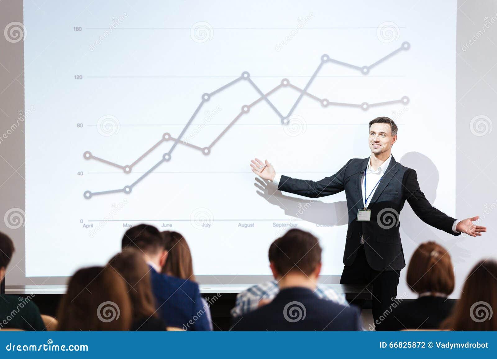 Speaker giving public presentation in conference hall