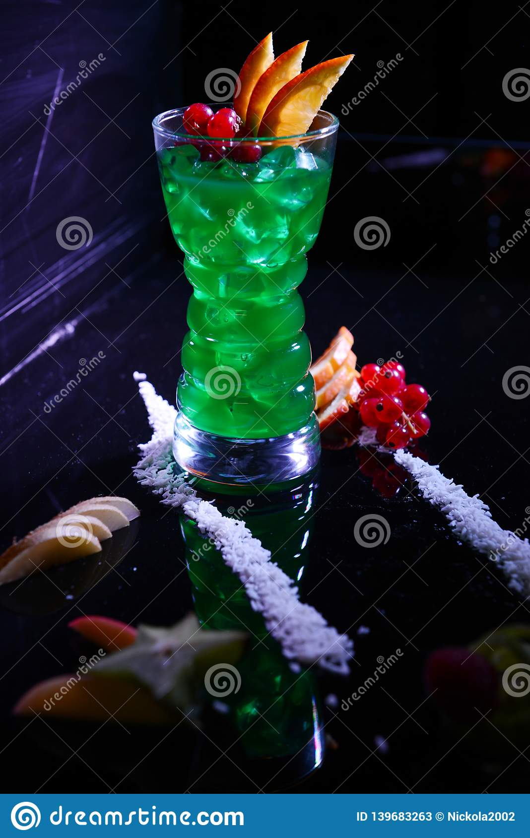 Spearmint juice with currants and oranges on a table