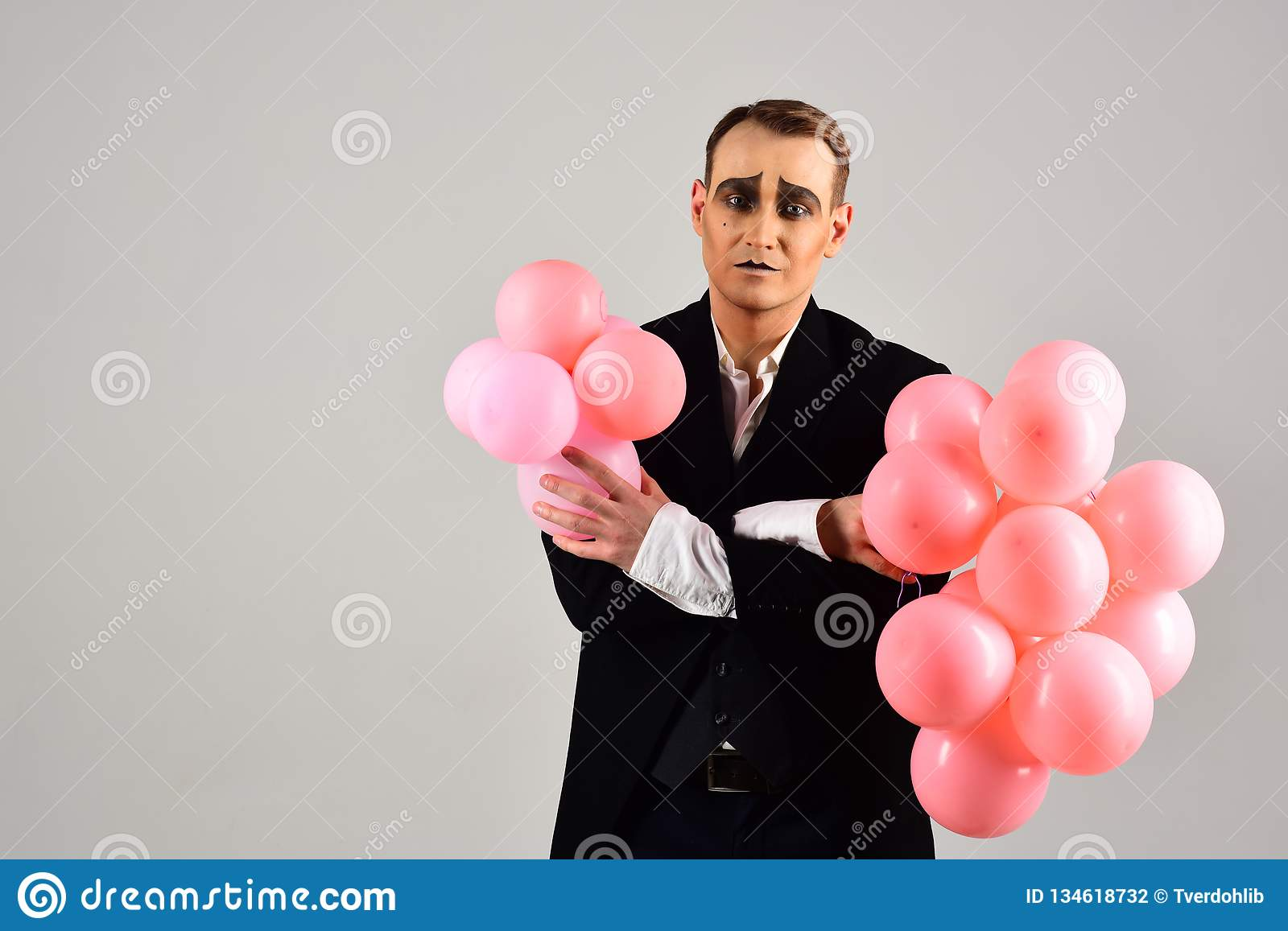 Special day to celebrate. Mime man with party balloons. Balloon artist. Man with mime makeup on birthday party. Happy
